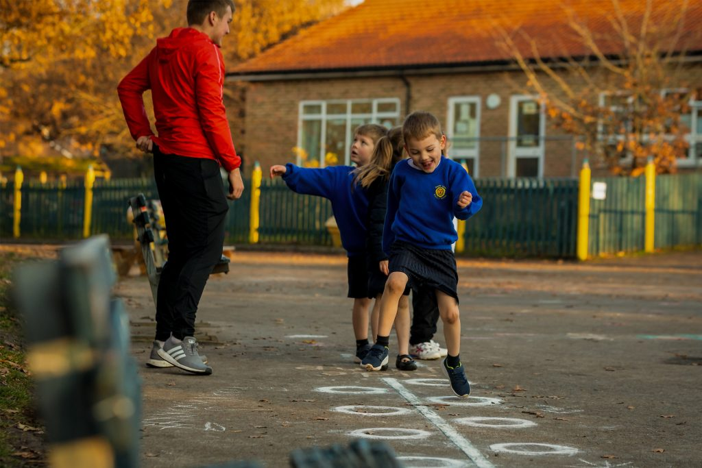 PlaySport - children having fun doing the hop scotch during a PE lesson